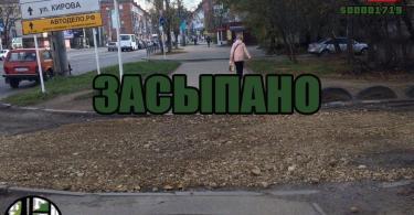 Лужа прямо посреди тротуара между первым домом по улице Нормандии Неман и домом №40 по улице Николаева
